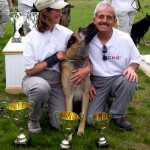 Canaille with handler Anne R. kisses training helper Jose